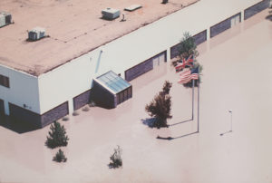 An image of the Mark Andy headquarters in 1993, surrounded by flood water.
