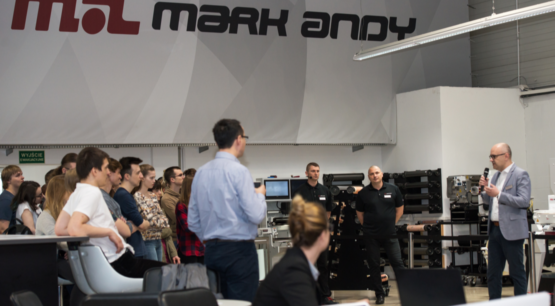 Mark Andy representative speaking about benefits of Mark Andy presses