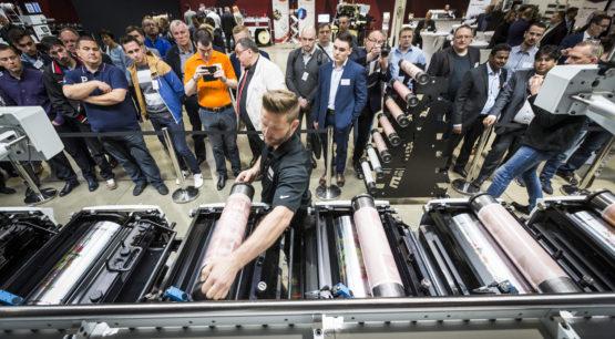 Man placing dies in a printer