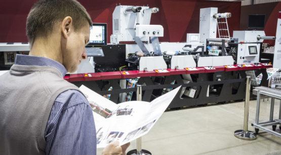 Man reading printer pamphlet